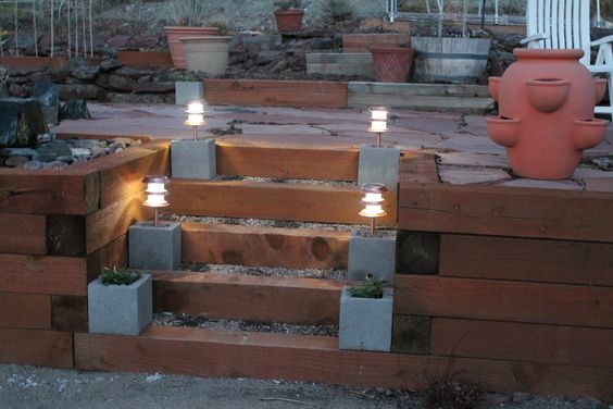 Make your own DIY bases for backyard solar lights using .98 cent concrete blocks!