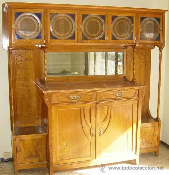 Aparador modernista Nouveau sideboard  Nineteenth century, oak and red marble, glass and beveled mirror.  At the top has five doors, two drawers in the lower central and two large doors and two small side, vegetable decorations.  Dimensions: height 204 cm, length 205 cm, depth 52 cm. $2800