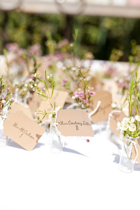 Lavender wax flowers with name cards..perfect for a rustic wedding