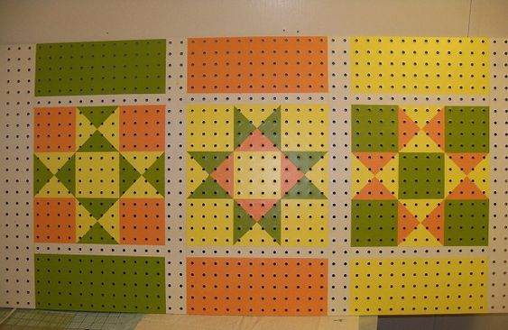 Pegboard painted with quilt block patterns.  Great way to brighten up a sewing room