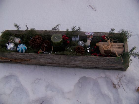 Table centerpiece made of original barnboard and Christmas decorating items!  Available at http://primitivecreations.webs.com