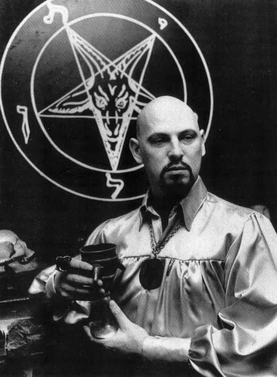 Portrait of Magus Anton Szandor LaVey in front of his altar