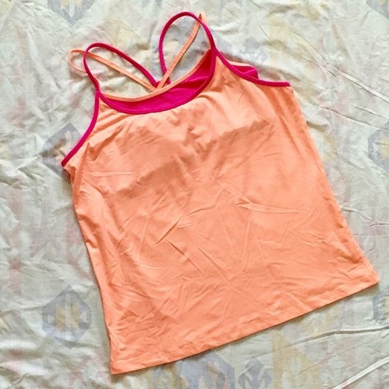 """NWOT Roxy """"Perfect Pair"""" Tank w/Bra Never worn! Accidentally bought 2 without realizing it! Bra straps are adjustable. Tank is """"cantaloupe"""" color. Bra is pink and matches the Asics Capri pants I have listed perfectly! Is XL but Roxy so runs a little more like a Large. Bra gives a little extra support to a big bust. Very versatile style and size. Bra is attached to tank at the front/top of bra cups but nowhere else so the tank drapes nicely and isn't skin tight. But, it also looks cute tied…"""