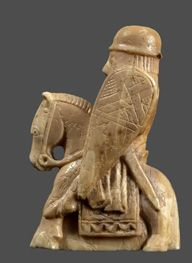 Right: Chess Piece in the Form of Knight, ca. 1250 CE. English. Walrus ivory. In the Metropolitan Museum of Art, New York City.