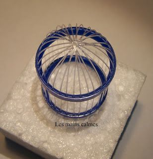 """Mini bird cage from plastic bottle rims and wires -- """"easy"""""""