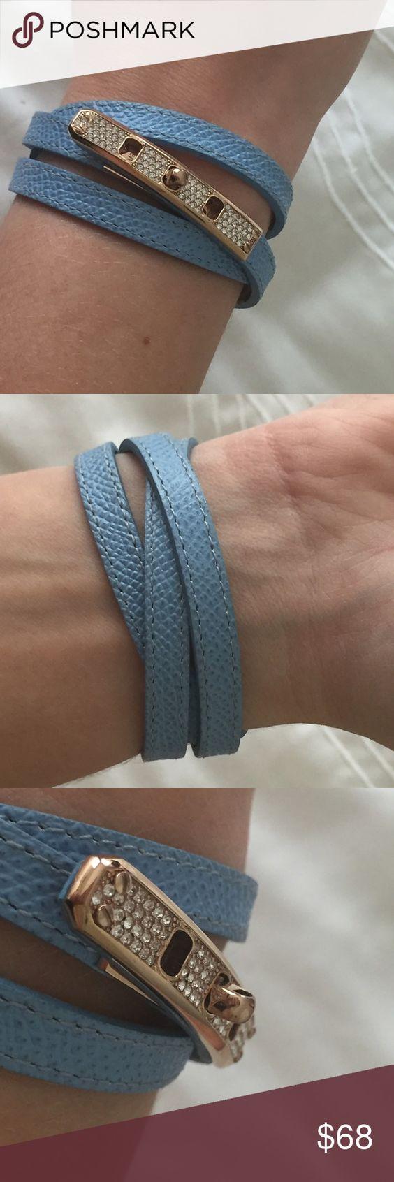 Henri Bendel wrap bracelet Light blue saffiano leather wrap bracelet. Turn-lock closure with clear Swarovski crystals in a rose gold plated setting. henri bendel Jewelry Bracelets