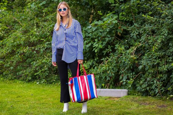 Pernille Teisbaek, with Balenciaga bag, in an A.W.A.K.E. shirt, and Vetements…: