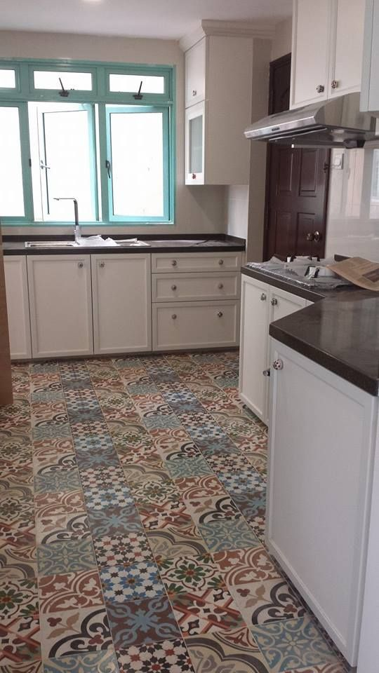 My new kitchen all done up with patchwork cement tiles. Love the white cabinets with the knobs I have chosen too. This will be my haven!