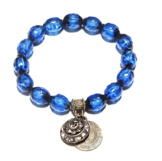 Hawaiian Blue Love Cures Bracelet --    Antique Czech Blue Glass Beads, pre-WWII with Swarovski vintage Crystal Charm bring life to our Love Cures stretch bracelet. -- $65.00