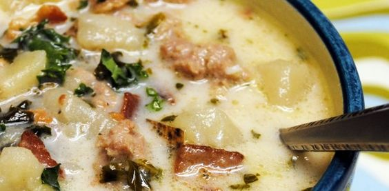 """Crock Pot Zuppa Toscana"" You can make this in a crock pot!! 1 lb. Italian sausage 2 large russet baking potatoes , sliced in half, and then in 1/4 inch slices 1 large onion , chopped 1/4 c. bacon bit (optional) 2 garlic cloves , minced 2 c. kale or 2 c. swiss chard , chopped 16 oz. cans chicken broth 1 quart water 1 c. heavy whipping cream"