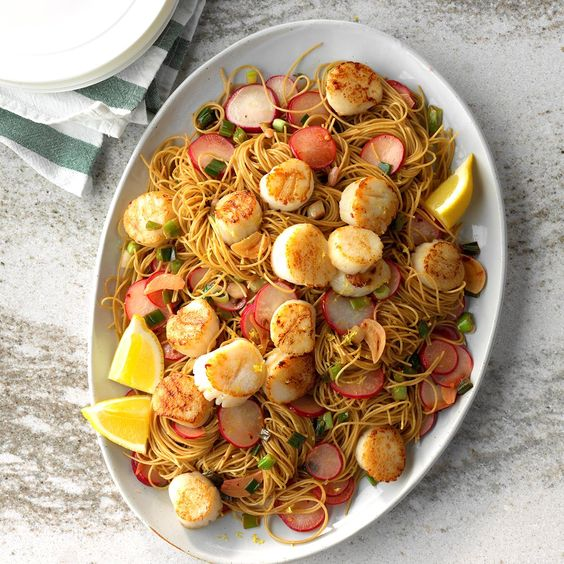 This delicate dish tastes so bright with a touch of lemon and tender sauteed scallops. Serve with crusty whole grain bread, and you've got an impressive dinner that comes together in a flash. —Thomas Faglon, Somerset, New Jersey