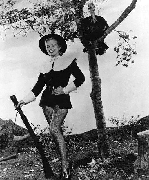 Marilyn Monroe - 1950 - posing as a Pilgrim with shotgun and turkey for her 1950 Thanksgiving pictures