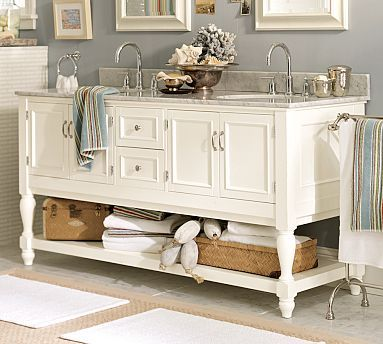 Classic southern bathroom sinks. Great storage and style! (PotteryBarn)
