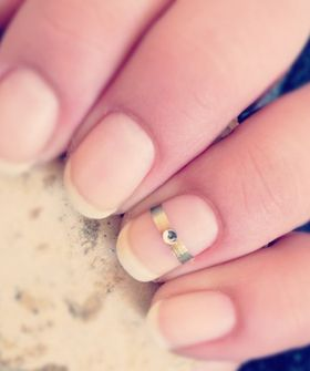 cute wedding manicure.....if the groom is nervous atleast the manicure would help get the ring on the right finger :)
