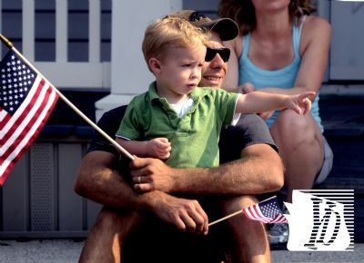 Matthew John of York City watches the Dallastown Memorial Day Parade along Main St. with his son Ethan, 1, and Eric, 5, (not in photo) Monday, May 28, 2012. Bill Kalina photo bkalina@yorkdispatch.com