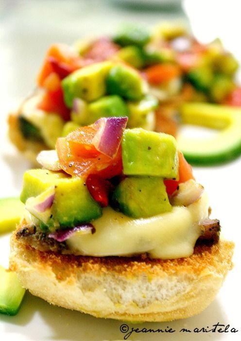 Bruschetta with slices of roasted pork tenderloin, melted gruyere & avocado salsa