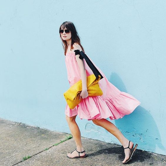 For an off-the-shoulder number that feels different from everyone else's, look for a bold color (like pink) and interesting sleeve details (like contrasting ribbon-ties).MSGM dress, Allison Mitchell bag, Katharine Page sandals. #refinery29 http://www.refinery29.com/2016/05/109647/new-outfit-ideas-may-2016#slide-26