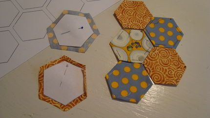 English paper piecing tutorial--it's a cute quilting style, although I wonder how happy I'll be to hand sew so much? (But would be great use of scraps!)