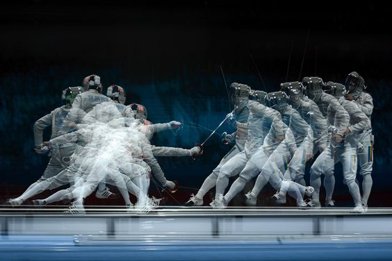 This multiple-exposure image South Korea's Kim Junghwan (R) fencing against Romania's Tiberiu Dolniceanu during the men's sabre team final as part of the fencing event of the London Olympic Games on August 3, 2012 at the ExCel center.    Photo: Toshifumi Kitamura/AFP/GettyImages