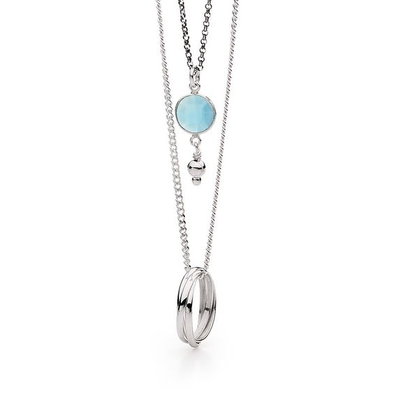 Sterling silver and ruthenium plated layered necklace with sterling silver trinity ring pendant and blue chalcedony gemstone pendant.This beautiful layered necklace makes a subtle statement and is perfect for all ages a stunning piece!