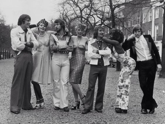 18 April 1973: IAN HUTCHINSON, ALAN HUDSON, STEVE KEMBER and BILL GARNER of CHELSEA FC join with professional models to show off a collection of clothes from the Mr Freedom fashion boutique on the King's Road...