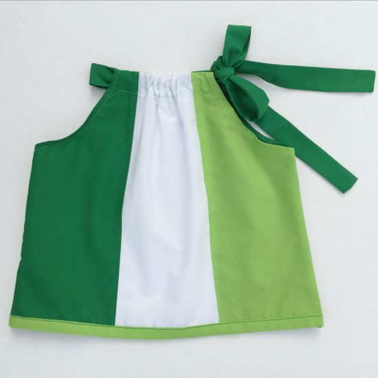Free Paneled Sun Dress Pattern. Sew this easy paneled dress for babies newborn through 24 months| DIY Crush