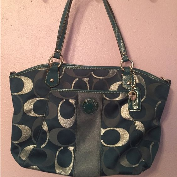 Coach purse Medium-large size aqua Coach purse. Hangs over the shoulder with a pocket on the back and in the front and a zipper pocket on the inside with two smaller pockets on the opposite side. Small makeup stain on the small zipper pocket on the inside. No tears but one of the straps is slightly chipped but nothing noticeable. Very comfy and spacious bag with a beautiful unique color. Coach Bags Shoulder Bags