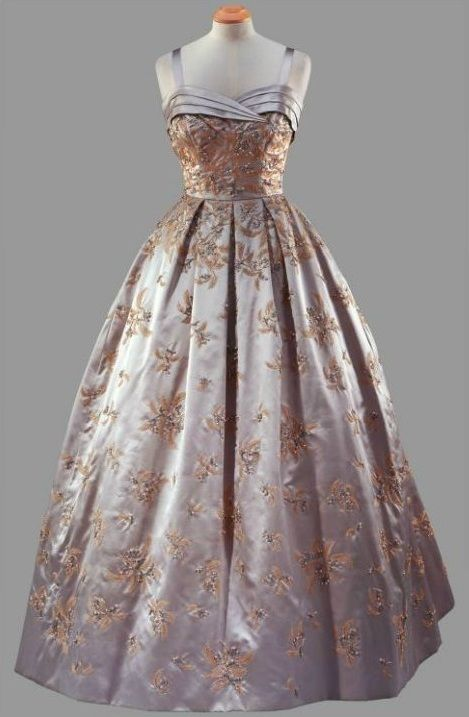 """Formal Gown, Hardy Amies: 1957, satin embroidered with bugle and beads and crystals. """"Worn [by HRH Queen Elizabeth II] during the State Visit to America, for a State Banquet at the White House given by President Eisenhower, October 1957."""""""