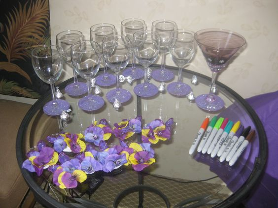 Purple Themed Bachelorette party - we made everyone their own wine glass with purple glitter mod podged on the base, the bride had her own hand made glass with rhinestones hot glued on and everyone wore matching hair clips that I made with a bobby pin, felt, silk flowers, rhinestones, a butterfly and hot glue.
