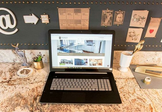 Painted bulletin board in chalkboard paint and framed in upholstery tacks. Home office small office space. Annie Sloan chalk paint. White decor. Gold decor.