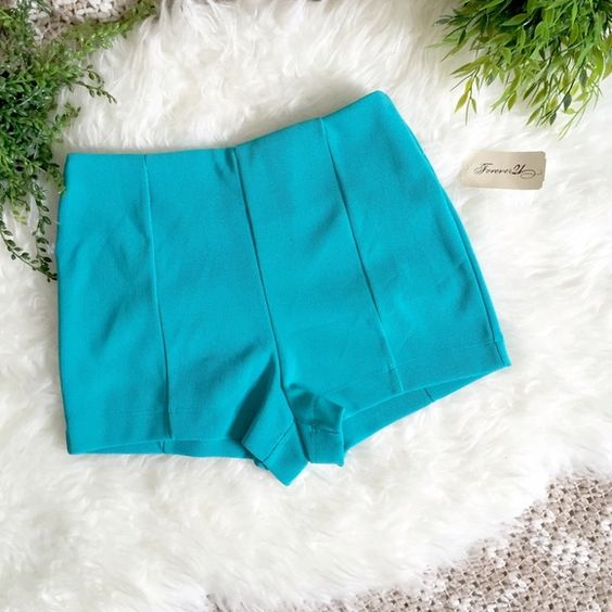 ⭐️ Thick Cotton Teal Hot Shorts Rave Shorts  Size: XS but could fit a small Brand:F21 Color: Teal/Silver Condition: NWT Damage: None Pricing: $5 (Etsy), $5 (M), $5 (Poshmark)  Terms & Conditions: ☾ Ships every Monday & Friday ☾Delivery in 2-5 business days with USPS ☾ Scammer warning: No Trades / $3listings ☾ Kandi purchases always come with free gifts ☾ Allergy warning: smoke free & hypoallergenic free pet home ☾ Don't need priority shipping ($6)? Ask for First Class ($4)! Hollister…