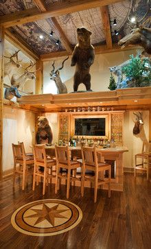 Hunter's man cave with game trophies displayed everywhere.