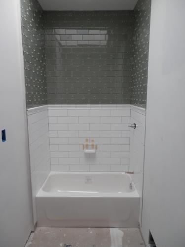 Bootz industries honolulu 46 1 2 in right hand drain for Bath remodel honolulu