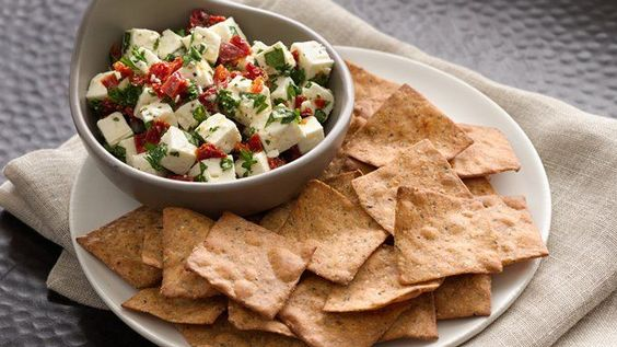 This marinated cheese made with fresh herbs has a taste of Greece. Enjoy with crackers or as a quick pasta topper.