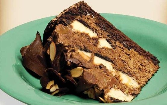 my ALL TIME favorite dessert. no question. Chocolate Eruption Cake! Chocolate mousse cake with chunks of cheese cake inside!!!! mmm.