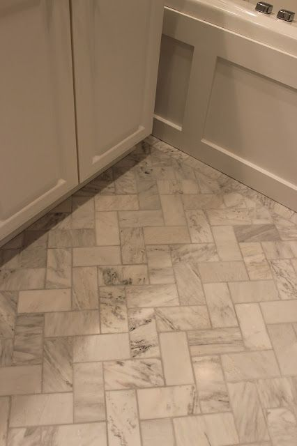 Master bathroom renovation herringbone floor alexandra for Small bathroom herringbone tile