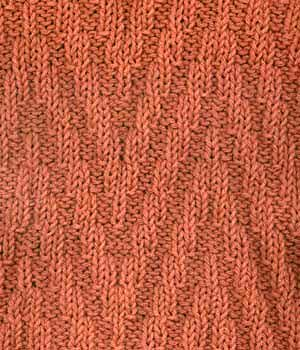 Reversible elongated chevron stitch...would be good for scarves.