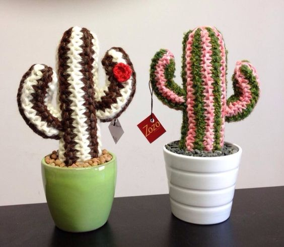 Cacti made to touch - no spikes! Woollen, hand knitted cacti caricatures, potted with pebbles. All plants are made to order and take a few days - if you have a particular colour preference, please let me know or I will choose for you. If you are ordering multiples, I will make sure you have a good variety.