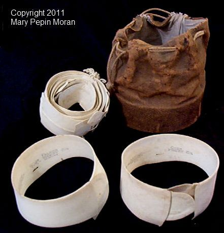 19th century cuffs and collars and leather bag.