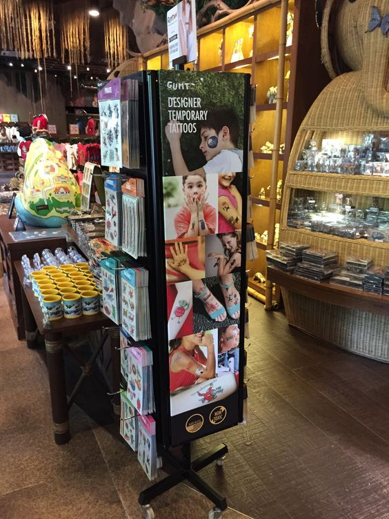 Temporary Tattoos retail display stand at Singapore Zoo store. To make it more attractive for customers we branded the display stand with pics: