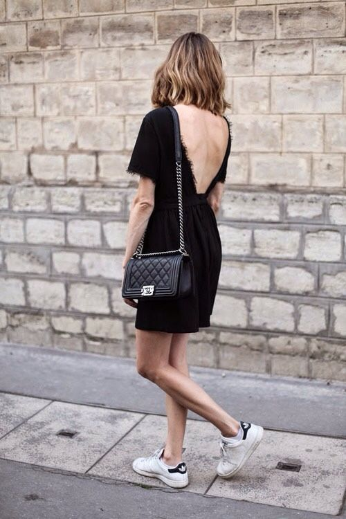 Shop this look on Lookastic:  http://lookastic.com/women/looks/black-lace-skater-dress-black-leather-crossbody-bag-white-low-top-sneakers/10274  — Black Lace Skater Dress  — Black Quilted Leather Crossbody Bag  — White Low Top Sneakers: