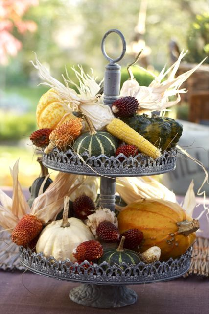 Use a tiered stand to display fall vegetables gourds for 3 tier pumpkin decoration