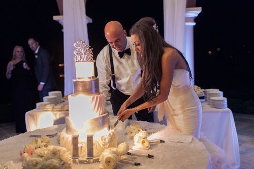 The cake cutting. Stephanie Di Lallo marriedJustin Oliver at a water frontwedding at The Westin Lake Las Vegas. Las Vegas Wedding Planner Andrea Eppolito | Wedding at Lake Las Vegas | White and Blush and Grey Wedding | Luxury Wedding Las Vegas