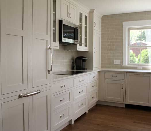 Starmark Cabinetry With A Painted Marshmallow Cream Tinted Varnish In The Stratfo Kitchen Cabinets Design Layout Kitchen Tiles Design Cost Of Kitchen Cabinets