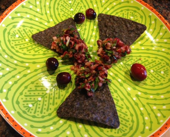 Cranberry salsa with blue chips.