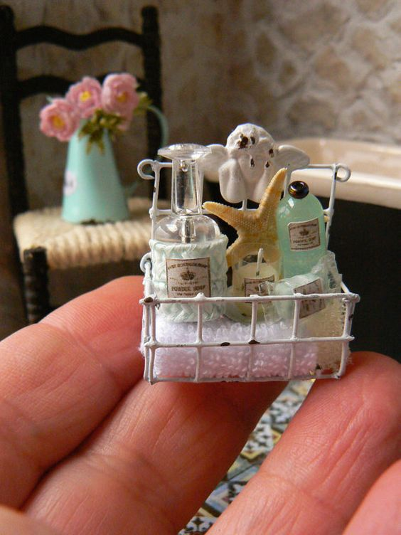 Basket for bathroom-Miniature Dollhouse  Is to support it on a wall, or to leave it hanging near the tub, to take bath products nearby.  A spa in your dollhouse.  Includes a small candle, scented candles mimics that light up when you take a bath.  Small towel, bottle of gel, aromatic oils, and a bar of soap scrub, getting out of the bath as goddesses.  Small wink of humor.  Please convo me