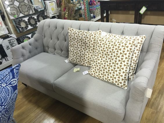 An awesome tufted couch bought at Homegoods
