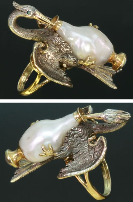 "French Antique Stork Ring from adinantiquejewellery. 18k yellow gold & silver with one big baroque pearl, one seed pearl at the outside of the bottom of the ""jar"". Two little stones, one onyx & one turquoise:"