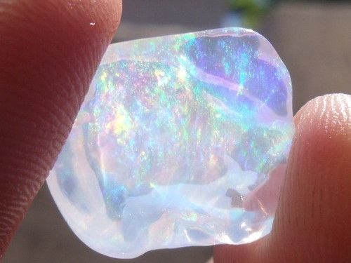 "opal, the color is true OPAL ESSENCE ""IRRIDESCENT"" i could see this incorporated into my engagement ring."