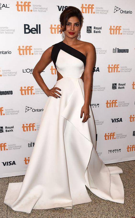 Sleek and Simple from Priyanka Chopra's Best Looks  Bollywood babe,Quantico's leading lady, bnascent sartorial goddess. The actress stunned inGauri & Nainika at the2014 Toronto International Film Festival.